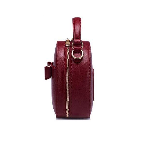Okrągła torebka listonoszka Kokardka