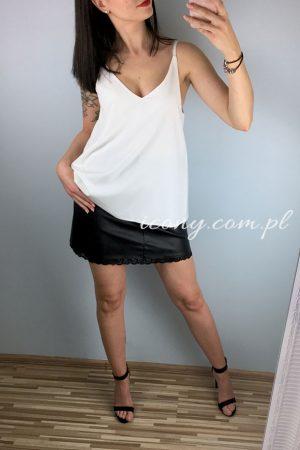 elegancki top damski na cienkich ramiączkach w połączeniu z czarną skórzaną spódnicą.